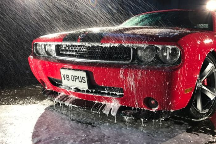 image of a Dodge Challenger being cleaned